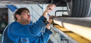 Contract vehicle technician working on a car